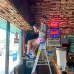 Bar Owner Removes $3,714 Worth Of Bills Stapled To The Walls To Pay Unemployed Staff photo