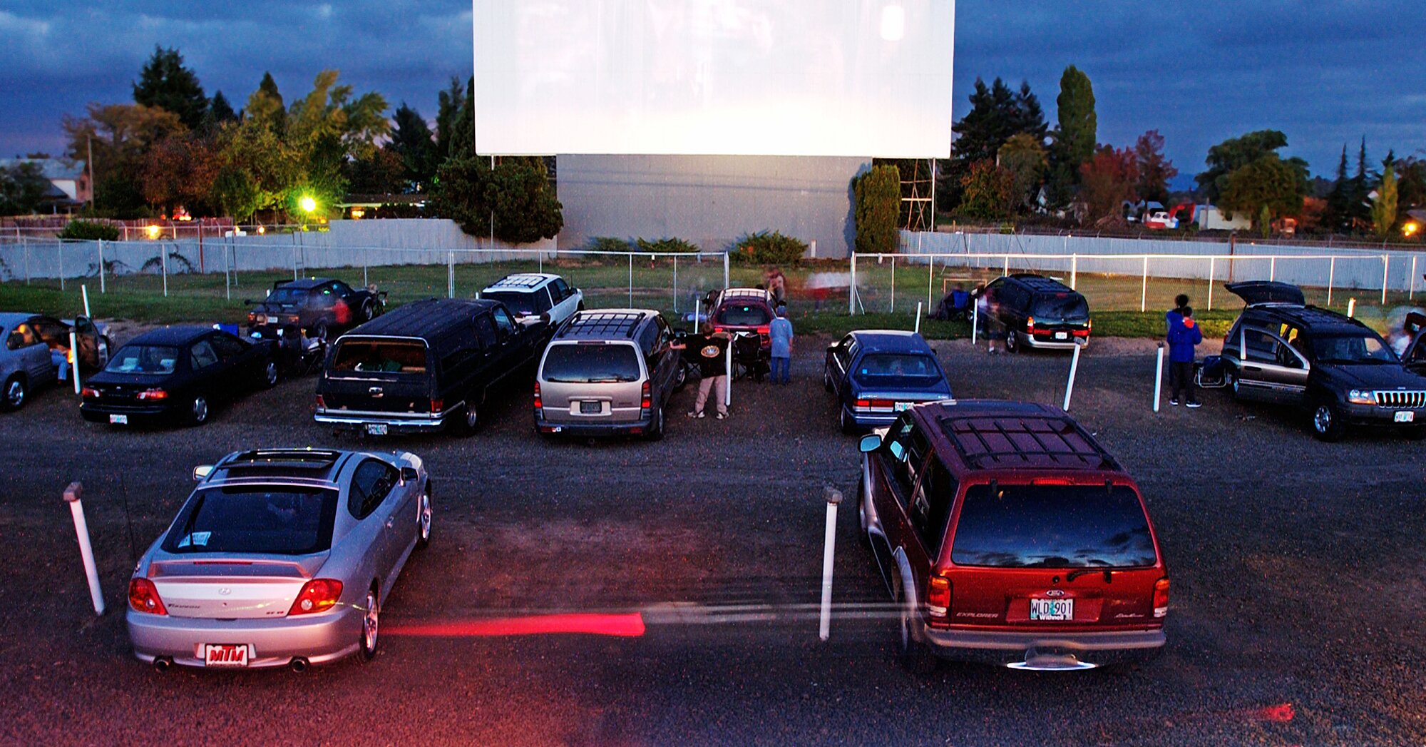 Restaurants Are Turning Their Parking Lots Into Drive-in Movie Theaters photo