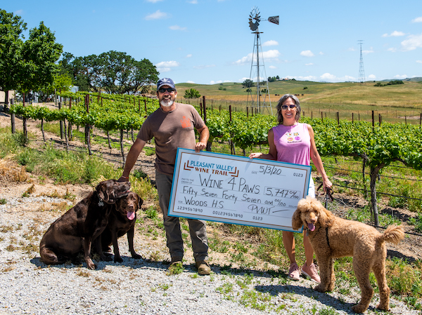 Pleasant Valley Wine Trail Donates Over $5k To Woods Humane photo