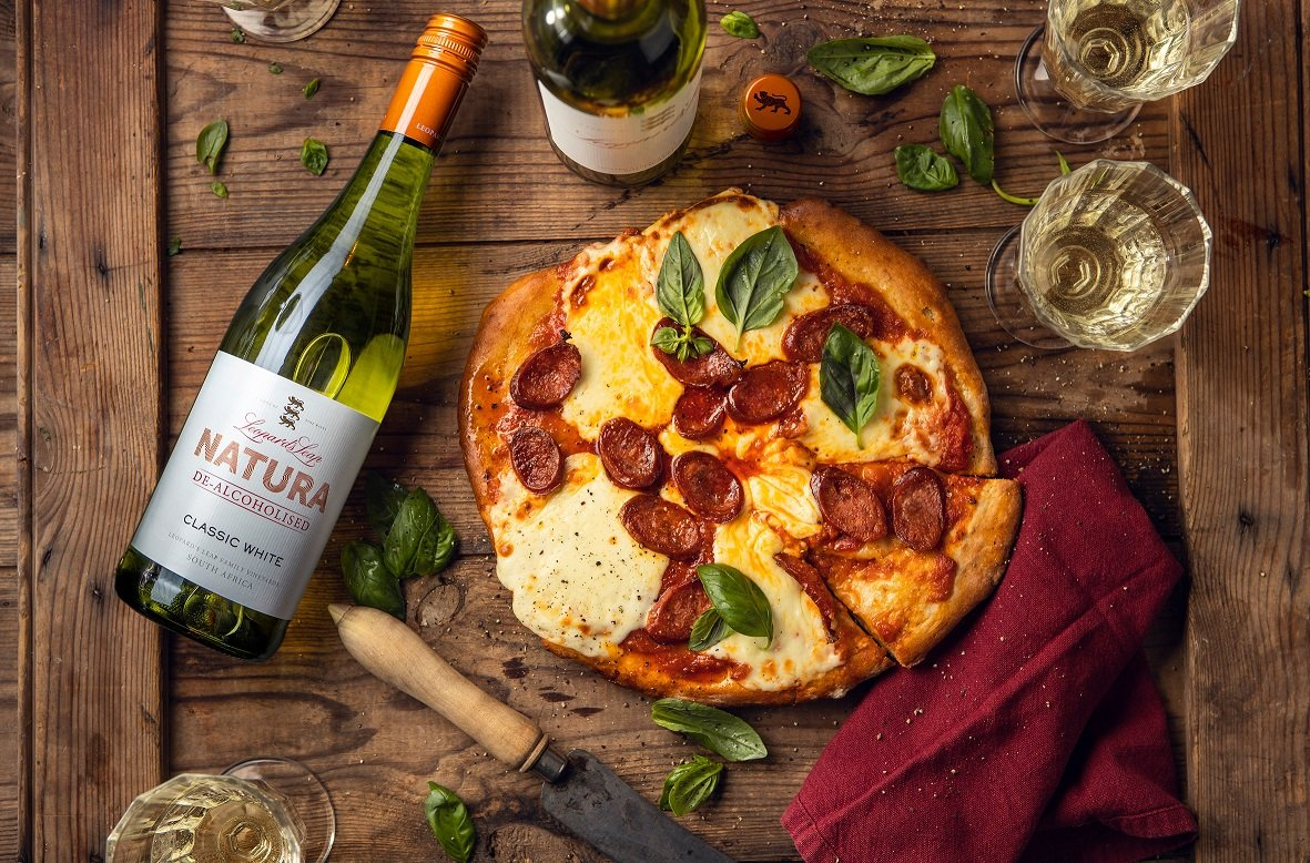 Homemade Pizza With Smoked Mozzarella, Chorizo And Fresh Basil photo