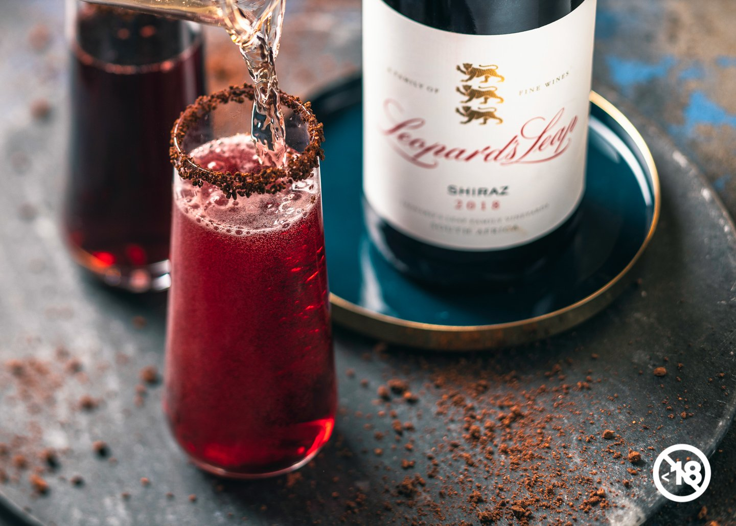 Spicy Sparkling Shiraz Cocktail With Dark Chocolate Nibs photo