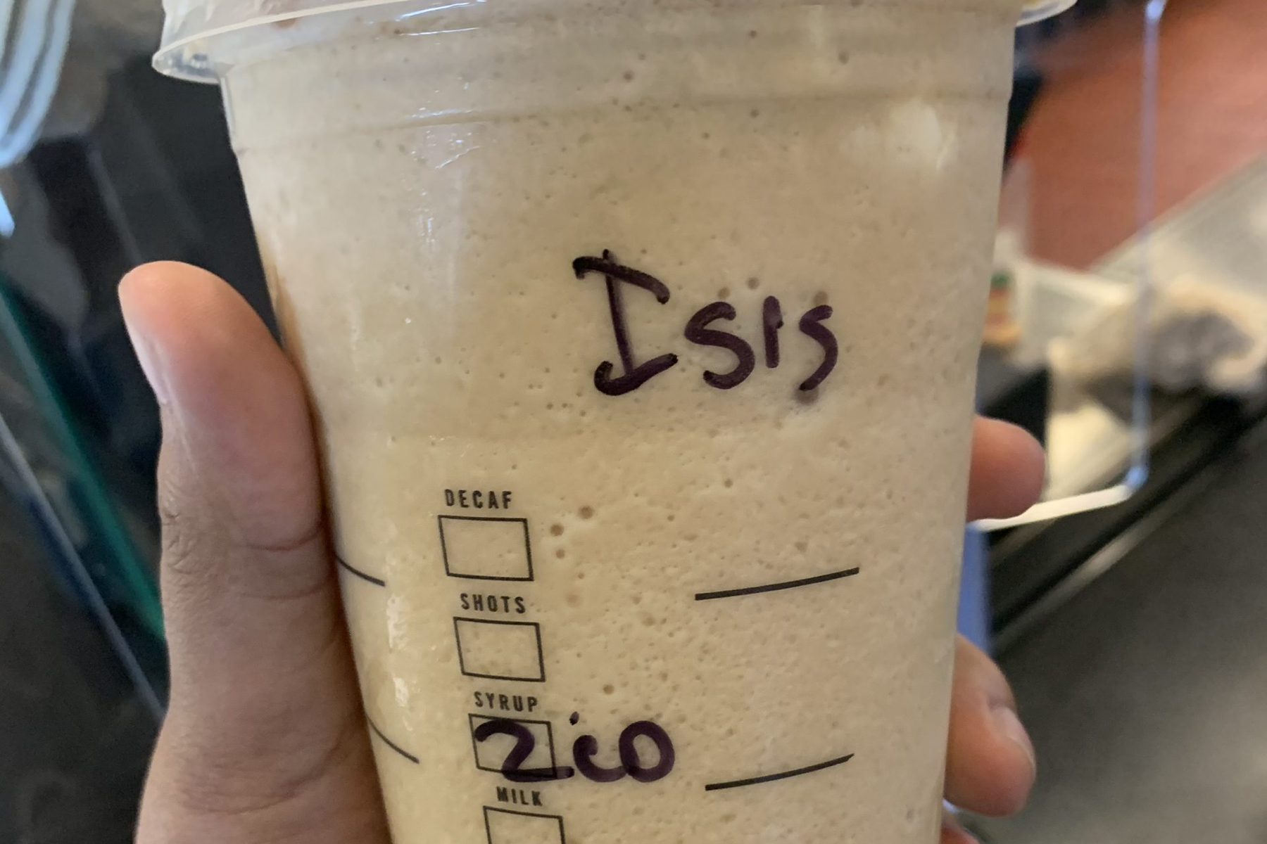 A Muslim Woman Ordered A Drink At Starbucks. The Barista Wrote 'isis' On Her Cup. photo