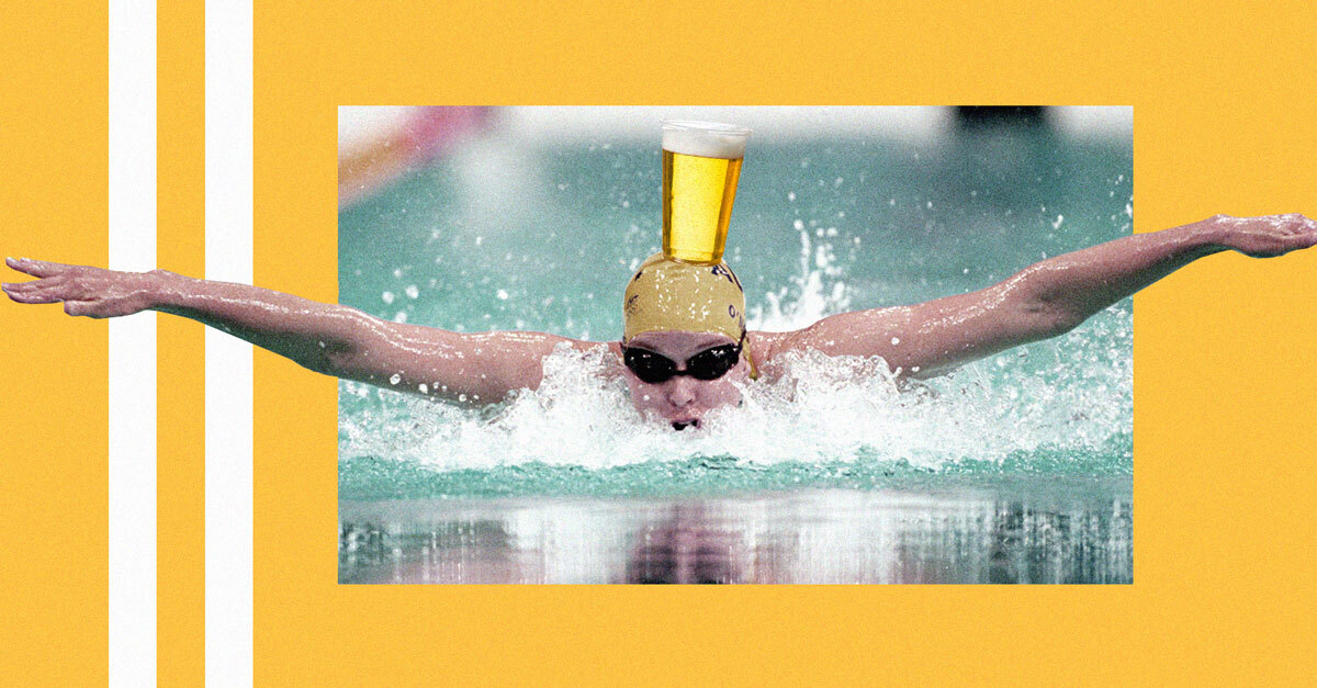 Olympic Athlete Swims 25 Meters With Full Beer Glass Balanced On Head photo