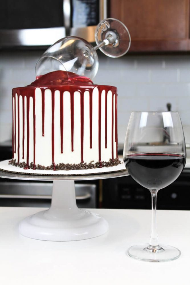 vertical dramatic uncut wine cake on white cake stand with glass of wine 683x1024 1 667x1000 Food and Drink Inspired Cakes For Weddings, Birthdays or Any Random Celebration