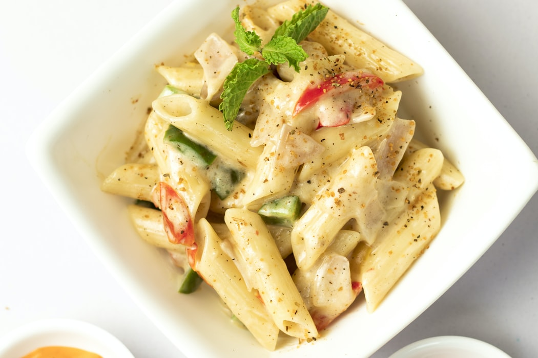 Double Pasta Portion and Bottle Red Wine photo
