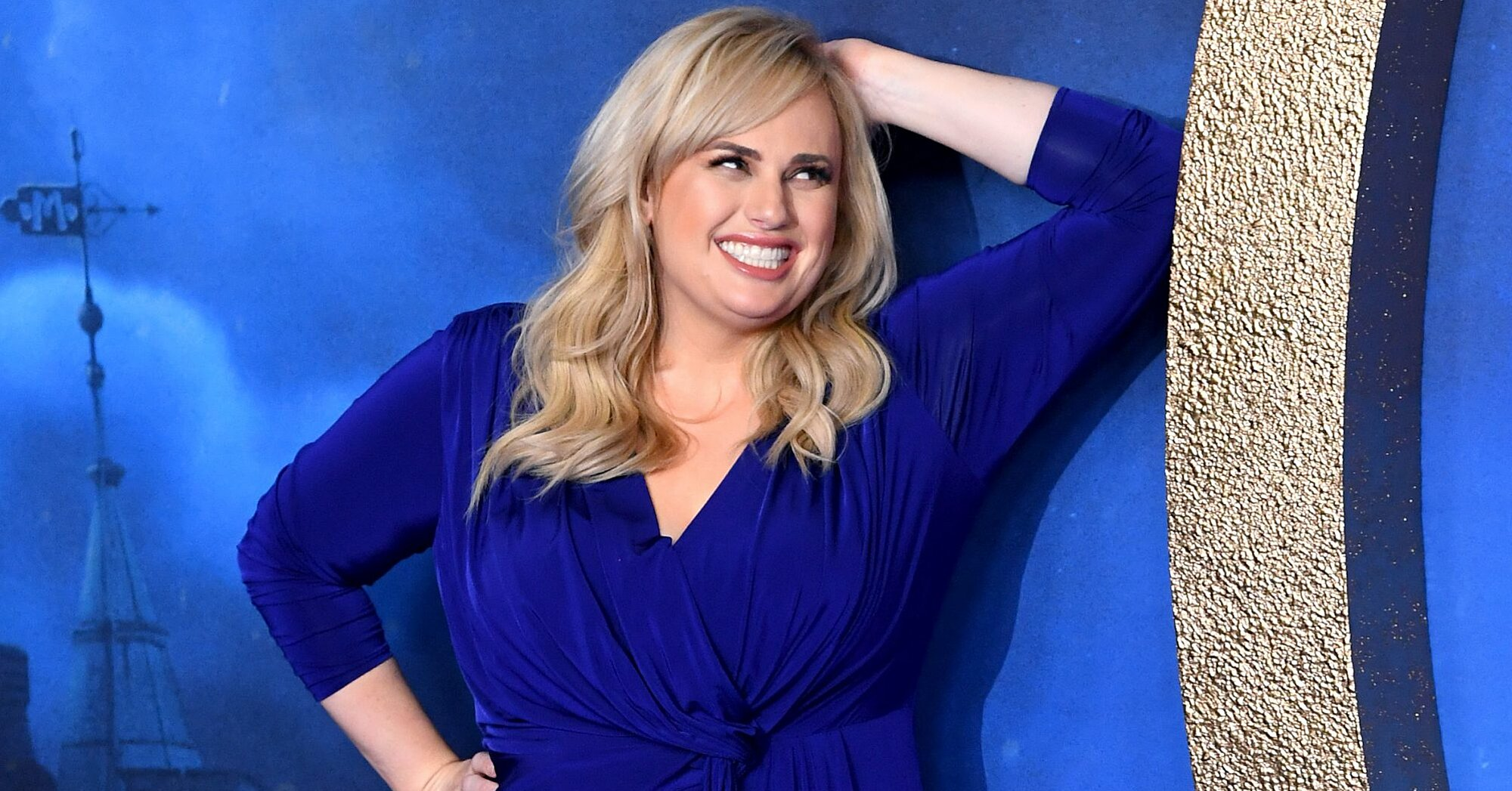 You Need To See This Video Of Rebel Wilson Doing Arm Workouts With A Big Bottle Of Vodka photo