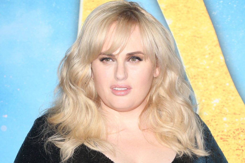 Rebel Wilson's New Workout Involves A $1,980 Gucci Dress & A Bottle Of Grey Goose photo