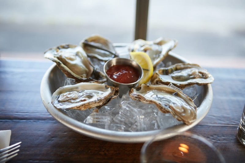 Six oysters and a glass of bubbly photo