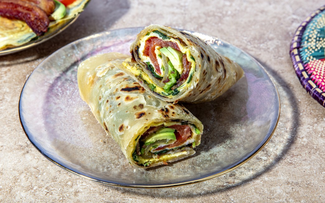 Rolled Roti Omelet With Avocado, Bacon And Tomato photo