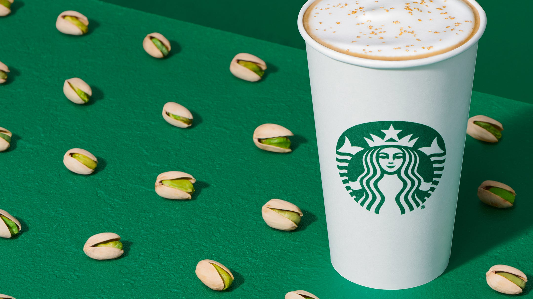 Starbucks Releases Winter Menu With New Pistachio Latte, Honey Almondmilk Cold Brew, Red Velvet Loaf And More photo