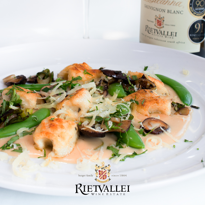 Creamy Goats Cheese Gnocchi Paired With Rietvallei Estate Estéanna Sauvignon Blanc photo