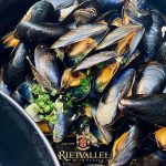 Steamed Mussels In A Creamy Lemongrass Sauce Paired With Rietvallei Classic Sauvignon Blanc photo